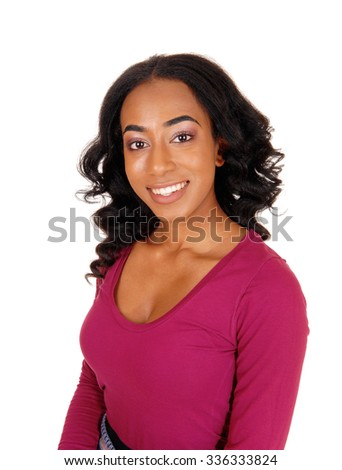 A lovely African American woman with long curly black hair smiling in a portrait image, isolated for white background.  - stock photo