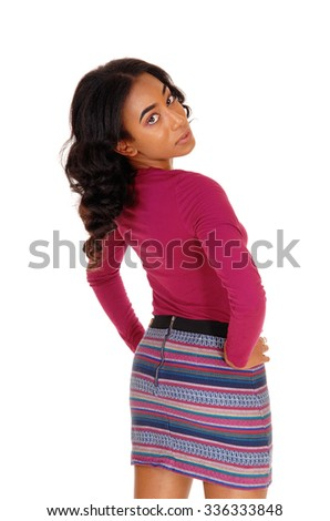 A lovely African American woman with long curly black hair standing from the back and bending backwards, isolated for white background.  - stock photo