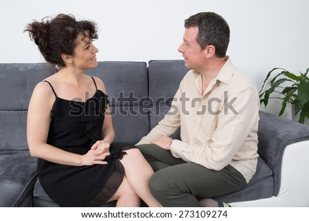A lovely and Cheerful couple on their couch