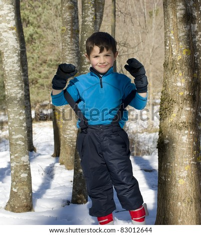 A lovely child posing on the snow