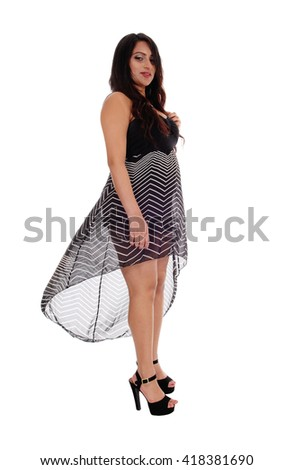A lovely East Indian woman standing in a lovely dress in high heels, 