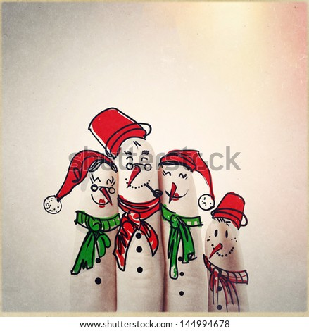A lovely family hand drawn and finger of snowmen,as concept idea - stock photo