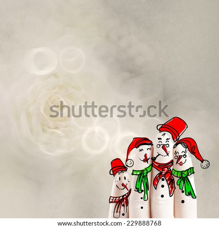 A lovely family hand drawn and finger of snowmen on flowers nature background as concept idea  - stock photo