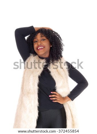 A lovely happy young African American woman in a black dress and a white