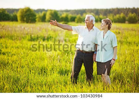 A lovely portrait of a happy senior couple outdoors.