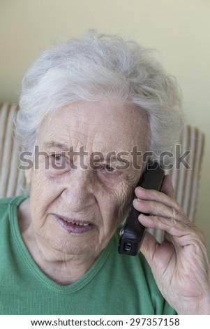a lovely senior woman on phone - stock photo