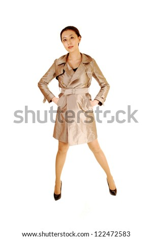 A lovely tall Asian business woman in a beige light coat standing in the studio for white background.
