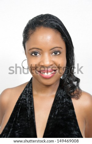 A lovely young black woman with a radiant smile. - stock photo