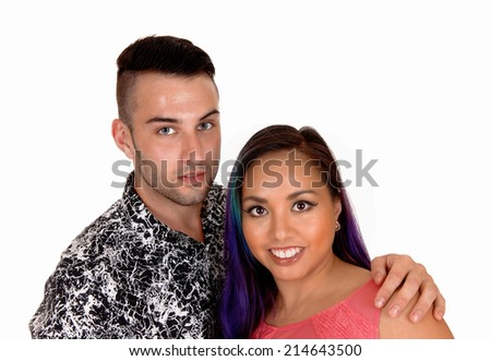 A lovely young couple, Asian girl and Caucasian man, in a closeup picture isolated on white background.  - stock photo