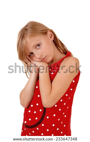 A lovely young girl holding her hands on her face, looking sad, isolated on white background.  - stock photo