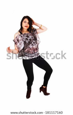 A lovely young girl in black tights and boots dancing for white background.