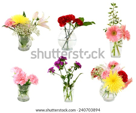 A lovey flower bouquet gift in glass vases - stock photo