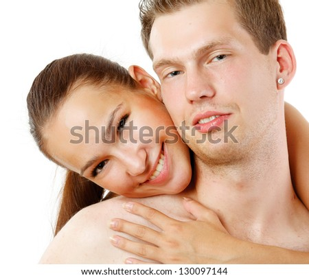 A loving affectionate nude heterosexual couple on the bed