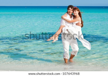 A loving couple is on the beach - stock photo