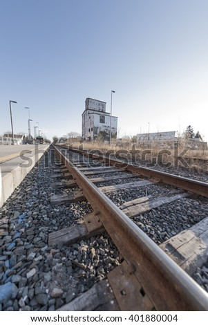 A low angle view of train tracks at a commuter station in Stouffville Ontario Canada.