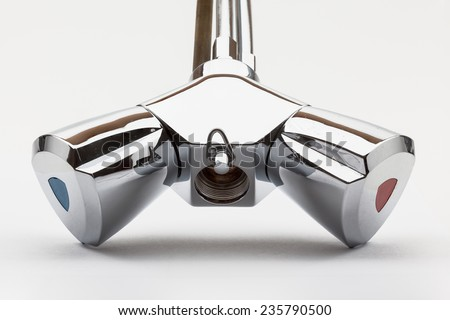 a low-pressure mixing tap on a white background - stock photo
