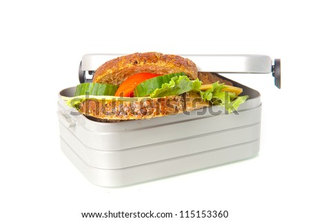 a lunchbox with a sandwich - stock photo