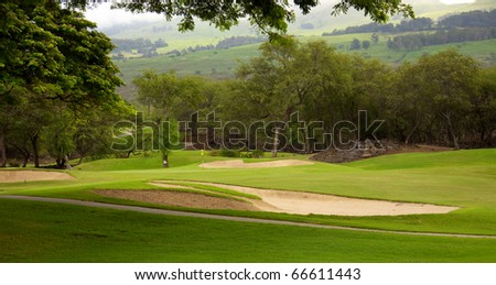 A lush green golf course in Kihei Maui, Hawaii - stock photo