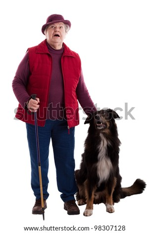 A lusty female senior with dog looks to viewer 2 - stock photo
