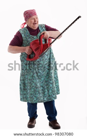 A lusty female senior with garden saw  looks to viewer 2 - stock photo