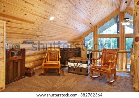 A luxurious loft with comfortable furnishings, in a modern log cabin in the mountains. - stock photo