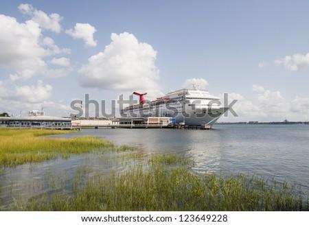 A luxury cruise ship docked in South Carolina near Wetlands in Charleston - stock photo