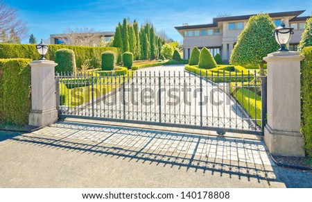 A luxury custom made house behind the gates in suburbs of Vancouver, Canada. - stock photo