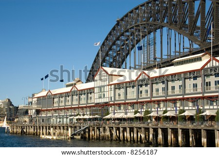 A luxury hotel, with the Sydney Harbour Bridge as a backdrop