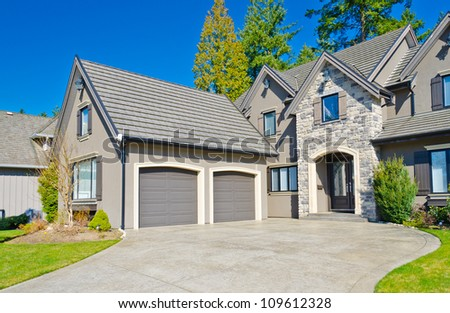 A luxury house with two garage doors in suburbs of Vancouver, Canada - stock photo