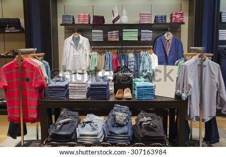 A luxury store with mens clothing. - stock photo