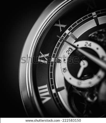 A luxury watch up close in black and white