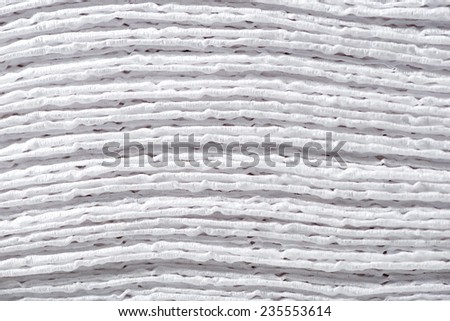 A macro close up of a stack of paper napkins background - stock photo