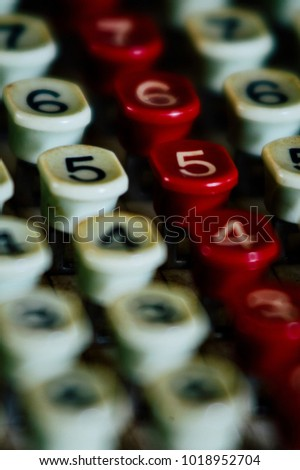A macro / detailed view of numeric keys on a retro adding machine that was left behind in the abandoned Parker Tobacco Company offices in Maysville, Kentucky.
