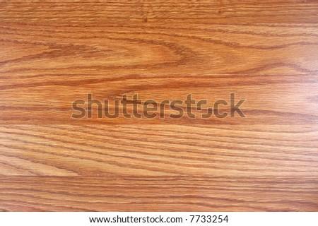 a macro of plank on wood floor - stock photo