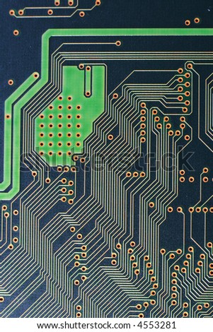 A macro photograph of a printed circuit board and components - stock photo