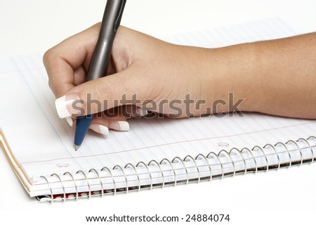 a macro picture of a female hand holding a pen