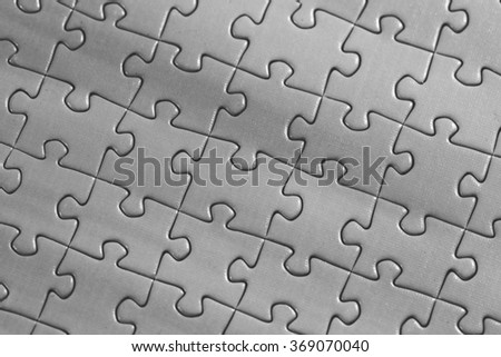 A macro shot of a puzzle. Image in black and white.