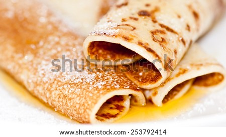 A macro shot of a trio of sugar coated pancakes. - stock photo