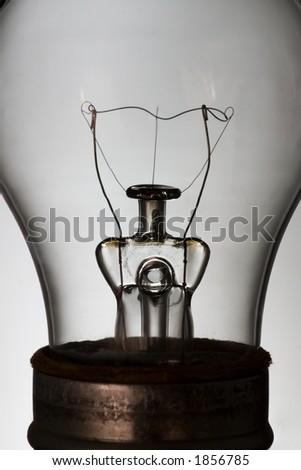 A macro shot of an unlit bulb - stock photo