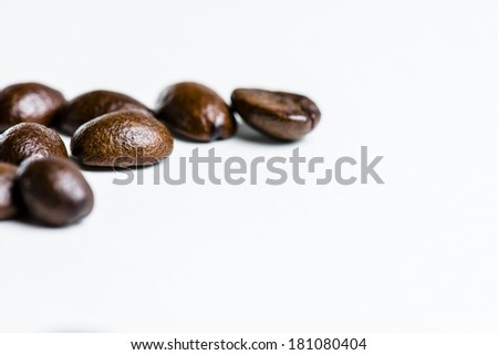 A macro shot of coffee beans with shallow depth of field. - stock photo
