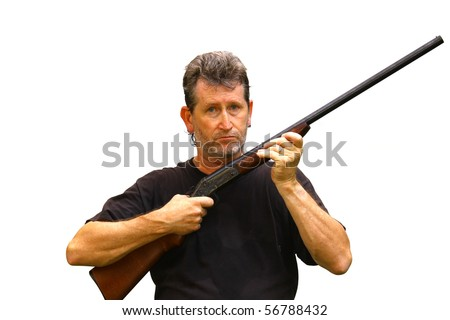 A mad man holding a loaded shotgun guarding himself and others with room for your text - stock photo