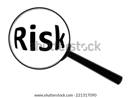 "A magnifying glass against white background increases the word ""Risk""."