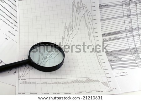 a magnifying glass, financial magazine
