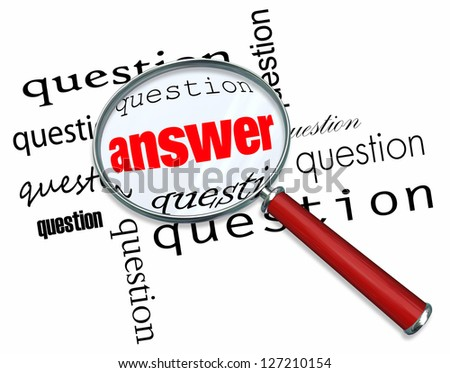 A magnifying glass hovering over many questions to find the answer - stock photo