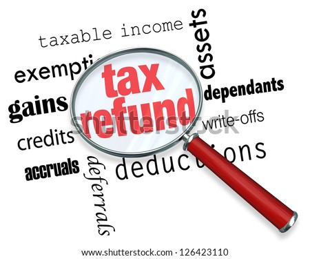 A magnifying glass hovering over several words, at the center of which is Tax Refund