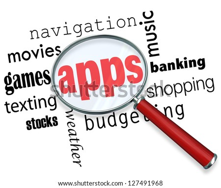 A magnifying glass hovering over several words describing different types of applications -- movies, games, texting, banking, weather, navigation and more -- and at the center is the word Apps - stock photo