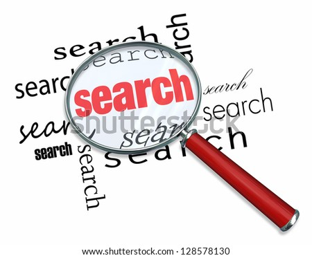 A magnifying glass hovering over the word Search - stock photo