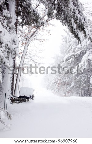 A mailbox on a snow covered road - stock photo