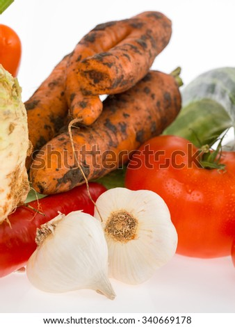 a main plant for proper , healthy food raw garlic carrot tomato - stock photo
