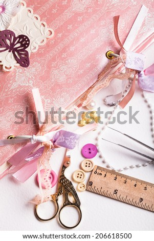 A making scrapbooking album with rings and decorations on the table and tools - stock photo